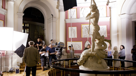 Image of A crew on location at UCL filming Inception