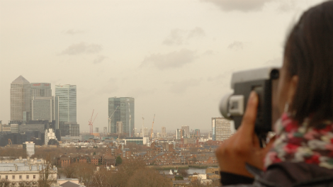 Image of A young film-maker points her camera at London