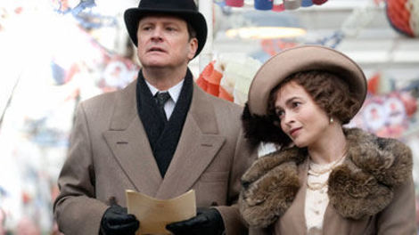 Image of Colin Firth and Helena Bonham Carter in The King's Speech wearing period clothing surrounded by bunting