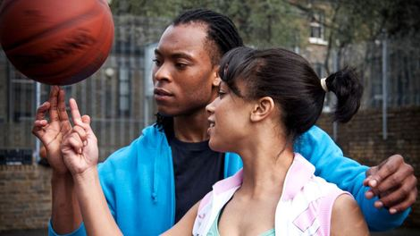 Image of A couple passing a spinning basketball to each other in Freestyle