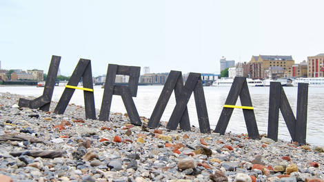 Image of The Jarman Award spelt out in letters on a beach