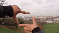 Image of Hands frame a shot of London