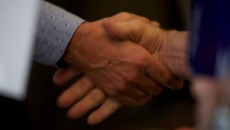 Image of Shaking hands at PFM