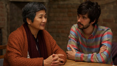 Image of Cheng Pei Pei and Ben Whishaw at a table in Lilting